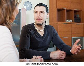 Ordinary man and woman talking