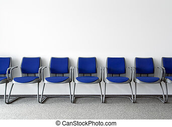 Ordinary waiting room - Blue chairs in ordinary empty...
