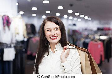 Ordinary woman at clothing store