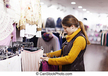 woman choosing clothes at store