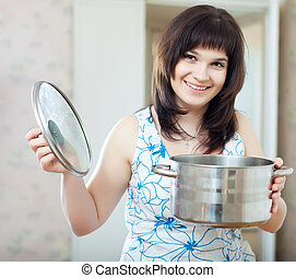 ordinary woman with cook pan at kitchen