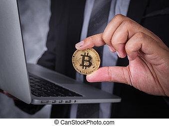 ordinateur portatif, bitcoin, tenant main