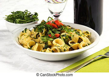 orecchiette, with rucola salad and tomatoes