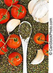 Oregano, garlic and red cherry tomato
