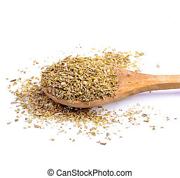 Oregano in spoon on isolated  white background.
