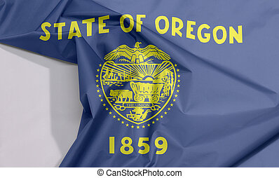 Oregon fabric flag crepe and crease with white space, The states of America, cost of arm in gold color on blue field.