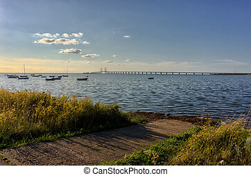 Oresund and Oresund Bridge viewed from the Swedish side. The bridge is 7845 meters long and continues into the Drogden tunnel which measures 4050 meters.