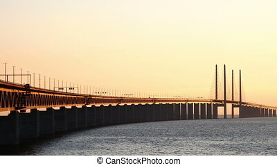 Oresund Bridge at dusk. Strait between Sweden and Denmark