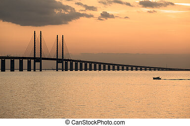 Oresund Bridge at dusk viewed from the Swedish side The bridge is 7845 meters long and continues into the Drogden tunnel which measures 4050 meters