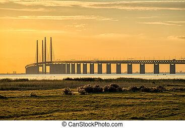 Oresund Bridge at dusk viewed from the Swedish side. The bridge is 7845 meters long and continues into the Drogden tunnel which measures 4050 meters.
