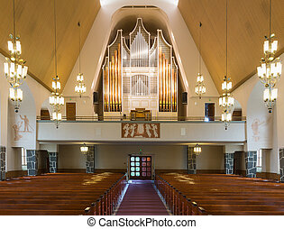 Organ consecrated in 1987 holds 4000 pipes and possesses 45 registers, at Rovaniemi main church. Part of ceiling and church interior also in photo.