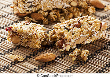 Organic Almond and Raisin Granola Bar on a background