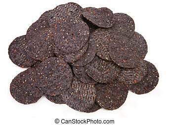 Organic Blue Corn and Sesame Tortilla Chips - Pile of blue...