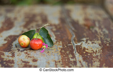 Organic Brazilian Acerola Fruit small cherry put on wooden...