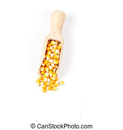 Organic corn drop out of wood spoon