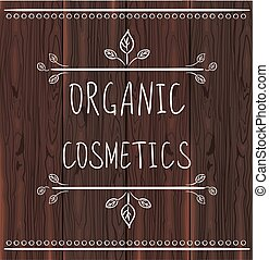 ORGANIC COSMETICS handwritten letters on brown wood background
