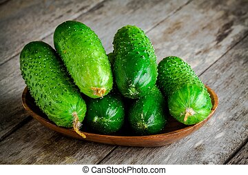 organic cucumbers in a wooden bowl