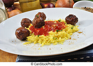 organic curry rice with meat balls on a plate