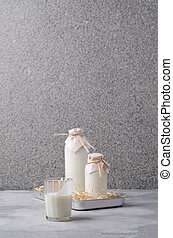 Organic dairy product in glass on shale background. ...