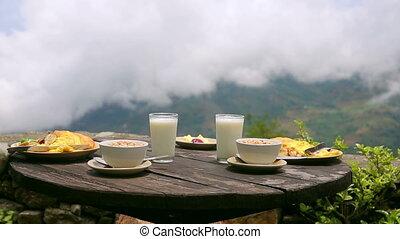 Organic delicious breakfast on wooden table at himalayas mountain, Nagarkot, Kathmandu, Nepal