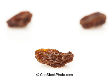 Organic Dried Raw Raisins against a background