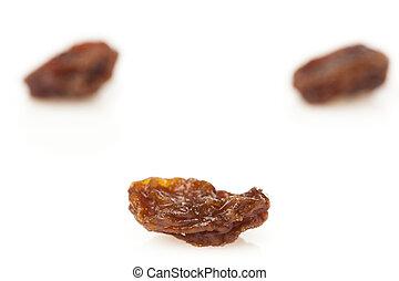 Organic Dried Raw Raisins against a background