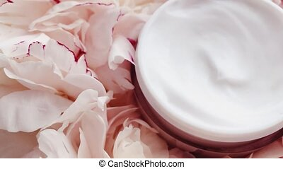 Organic face cream jar and peony flowers, clean moisturizer as skin care routine for luxury cosmetic, beauty product and skincare brands