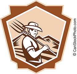 Illustration of organic farmer with pitchfork facing front set inside shield done in retro woodcut style