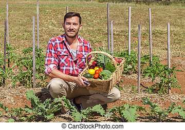 Organic farmer with fresh fruit and vegetables in garden