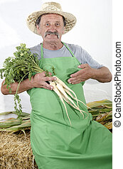 organic farmer with some radish in his hand
