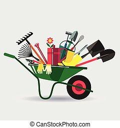 Organic farming. Wheelbarrow with tools to work in the...