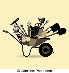 Organic farming. Garden wheelbarrow with tools. Devices for...