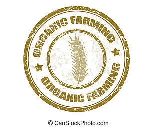 Grunge rubber stamp with wheat symbol and the text organic farming written inside