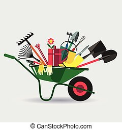 Organic farming. Wheelbarrow with tools to work in the ...