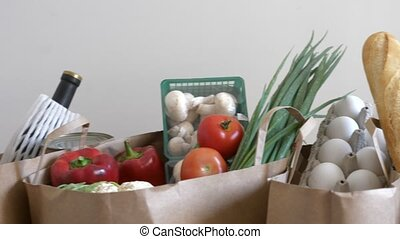 Organic food concept - Groceries paper bags filled with...