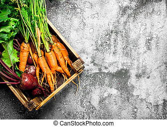 Organic food. Vegetables in an old box.