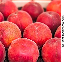 Organic fresh ripe peaches a local farmer market. Healthy...