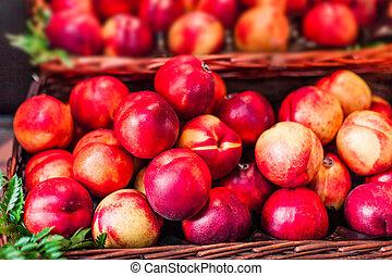 Organic fresh ripe peaches a local farmer market. Nectarines...
