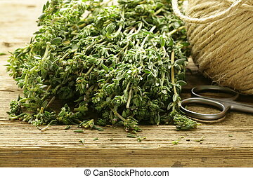 Organic fresh thyme on a wooden table