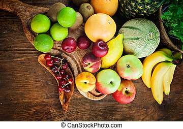 Fruit variety - Organic Fruit variety on wood. Tropical ...