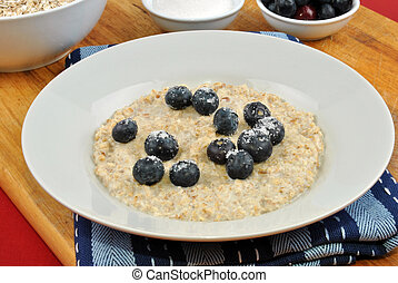 organic fruit with porridge on a plate