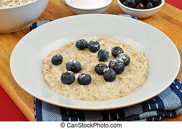 organic fruit with porridge on a plate