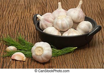 Organic garlic on the wooden background