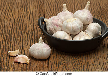 Organic garlic on the wooden background