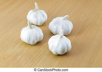 Organic garlic whole on the wooden background