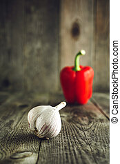 Organic garlic with bell pepper on a wooden table