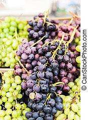Organic Green and black grape on a local farmer market....