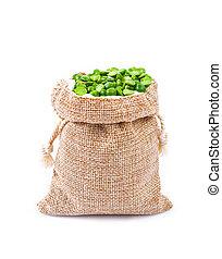 organic green split peas filling in sack bag.