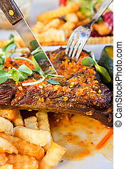Organic Grilled Lamb steak and vegetables