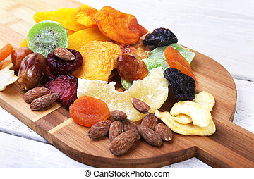 Organic Healthy Assorted Dried Fruit on bamboo wine board. Selective focus.